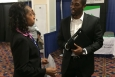 EM's Human Capital and Corporate Services Acting Deputy Assistant Secretary Melody Bell talks with Michigan State University engineering student Harold Hill at the BEYA conference.