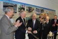 Federal, state and local Kentucky officials joined Secretary of Energy Dr. Ernest Moniz (third from left) and Senate Majority Mitch McConnell on September 10, 2015 as they cut the ribbon introducing the new Paducah Site wall display on the Fifth Floor of DOE's Forrestal Building in Washington, D.C.  Pictured (left-right) are: U.S. Rep. Ed Whitfield, Sen. McConnell, Secretary Moniz, Paducah Mayor Gayle Kaler, McCracken County Judge-Executive Bob Leeper, Clyde Elrod, and Dr. Len Peters, Secretary of the Kentucky Energy and Environment Cabinet.  Mr. Elrod was Charter President of the Paducah Area Community Reuse Organization and was involved with the construction of the Paducah plant. (EM photo by David Sheeley)
