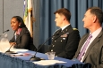 Bell speaks during the DOE's Veterans Day celebration as Anders, center, and Barnhart listen.