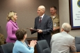 Thomas D'Agostino, right, who retired this month as Under Secretary for Nuclear Security and NNSA Administrator, presents EM's Candice Trummell with the NNSA Gold Medal earlier this month.