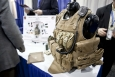 """At the 2013 ARPA-E Energy Innovation Summit Technology Showcase, the U.S. Marine Corps table featured a special vest with built-in solar cells, while the U.S. Army table highlighted a vest with a built-in fuel cell battery -- two ways to help efficiently power technology for American soldiers.   Photo by <a href=""""/node/379579"""">Sarah Gerrity</a>, Energy Department."""
