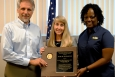 SRR President and Project Manager Ken Rueter (left), SRR Director of Environmental, Safety, Health and Quality and Contractor Assurance Patricia Allen and SRR VPP Chair Donletta Watts (right) accept DOE's VPP Star of Excellence award.