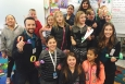 WRPS engineers Bryce Eaton and Ashley Ansolabehere pose for a photo with third graders at Maya Angelou Elementary in Pasco, Wash.