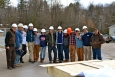 Team Middlebury at their Spring Build of the InSite, a 954 sq. ft. solar-powered home that's set to compete in the 2013 Solar Decathlon. Cordelia, Team Manager, is pictured sixth from the right.