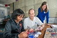 SRNS Engineer Michael Mitchell assists Jackson Middle School student Le'Landra Jarvis with a science project as her teacher Sally Brady looks on.