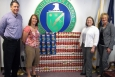 Mark Duff (LATA KY), Christa Dailey (Pro2Serve), Jennifer Woodard (DOE) and Kelly Layne (LATA KY) with an American flag constructed of donated food.