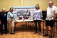 Nevada Site Specific Advisory Board (NSSAB) members, left to right, Pennie Edmond, Donna Hruska (NSSAB chair), Janice Keiserman, and Don Neill in front of the NSSAB display at the Groundwater Open House.