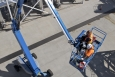 Workers use a lift to access part of the 200 West Groundwater Treatment Facility.