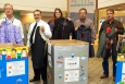 From left, NWP President and Project Manager Bob McQuinn, CBFO Manager Joe Franco, and CBFO organizers Margaret Gee, Martin Navarrete, and Dennis Miehls, hold up some of the donated coats that will be provided to Carlsbad area schools. CBFO organizers not pictured are Andrea Cooper, Kristi Squires, and Russ Patterson. NWP organizers not pictured are Bertha Cassingham, Dana Dorr, Yolanda Salmon, and Yolanda Navarrete.