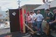 Participants watch a weatherization demonstration in Vermont, including techniques for the proper installation of a blower door. | Photo Courtesy of Capstone Community Action in Vermont