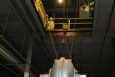 Workers lower a compressor from Portsmouth's X-326 process building, where it will be staged and prepared for shipping.
