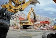 Workers demolish the CPP 601-602 Spent Nuclear Fuel Reprocessing Complex at the Idaho Site.