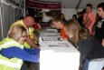 Students try their hands at arranging items in glove boxes during the Sixth Annual Science Alliance at the DOE Portsmouth Site in Piketon, Ohio.  The three-day event included several contests for hundreds of attendees while providing an immersive learning experience.
