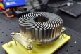 The Sandia Cooler's innovative, compact design combines a fan and a finned metal heat sink into a single element, efficiently transferring heat in microelectronics and reducing energy use. | Photo courtesy of Sandia National Laboratories.