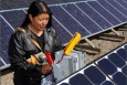 Deborah Tewa focused on tribal off-grid photovoltaic systems and renewable energy systems during her 2002 internship. Photo courtesy from Sandra Begay-Campbell, Sandia National Laboratories.