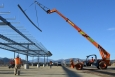 Construction workers build the frame for a 1-megawatt solar microgrid project at Fort Hunter Liggett, California.   <em>Photo courtesy of U.S. Army/Carlos J. Lazo</em>