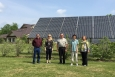 Six photovoltaic arrays generate 32 kilowatts of energy to power 20 units at the Akwesasne Housing Authority's (AHA) Sunrise Acres housing complex on the St. Regis Mohawk Reservation. Pictured from left to right are Paul Kabotie of Indigenous Collaboration, Inc., Rachel Sullivan of the National Renewable Energy Laboratory, Cecil Ransom of AHA, Sandra Begay-Campbell of Sandia National Laboratories, and Sheila Loran of AHA. Photo from Lesley Kabotie, Indigenous Collaboration, Inc.