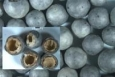 TerraCaps provide a novel method of encapsulating molten salt for increased thermal heat storage. 10- to 15-millimeter capsules provide high heat transfer surface. A void in the capsule accommodates the expansion of salt as it melts. Image from Terrafore