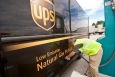 A UPS delivery truck is refueled with compressed natural gas. UPS plans to deploy 1,000 liquefied natural gas vehicles. | Photo by Pat Corkery, National Renewable Energy Laboratory