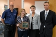 WRPS Compliance Programs Lead Lisa Bunch holds a plaque the company received from the Washington State Employment Security Department (ESD) for the company's commitment to hiring veterans. Also pictured are, from left to right, Dave Olson, WRPS president and project manager; Jennie Weber, ESD's eastern regional director; and Nick Erickson, the local veterans' employment representative.