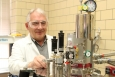 Dr. Vitalij Pecharsky in his research facility at Ames Laboratory, working with a calorimeter. <em>Photo courtesy of Ames Laboratory. </em>