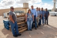WIPP environmental and operations personnel gather next to pallets that will be provided to the local community as part of WIPP's wood waste diversion program.