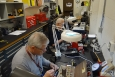 WEMS technicians Jim Snodgrass (left) and Jim Dixon set pins in security lock cores at the X-720 Lockshop.