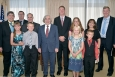Energy Secretary Ernest Moniz and other DOE officials gather with award winner Joshua Allen and his family at DOE headquarters earlier this month. Front row, left to right, Makenna Allen, Noah Allen, Secretary Ernest Moniz, Aria Allen, and David Allen; back row, left right, DOE Facility Representative Program Manager Earl Hughes, EM Operational Safety Office Director Terrance Tracy, Environment, Health, Safety and Security Associate Under Secretary Matthew Moury, Richland Operations Office Operations and Oversight Division Facility Representative Joshua Allen, Tera Allen, EM Assistant Secretary Monica Regalbuto, and EM Nuclear Safety Chief Chip Lagdon.
