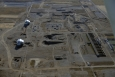 An aerial view of Hanford's D Area shows the D Reactor (lower left) and DR Reactor. Workers are digging 85 feet to groundwater at two sites there to remove chromium contamination.