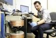 ORNL mechanical engineer Ayyoub Momen works on a magnetocaloric proof-of-concept refrigeration prototype. Image credit: Jason Richards, ORNL.