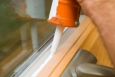 Caulking is an easy way to reduce air leakage around your windows. | Photo courtesy of ©iStockphoto.com/BanksPhotos