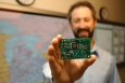 """Researchers at Pacific Northwest National Laboratory helped develop this integrated circuit to help make home appliances more responsive to the electric grid. When installed in refrigerators, air conditioners, water heaters and other appliances, the 2.5-inch Grid Friendly Appliance Controller can recognize when there's a power grid overload -- and will switch your appliances off and back on again to help conserve that energy. The device will help consumers lower their electricity bills while helping power plants work more efficiently. <a href=""""http://availabletechnologies.pnnl.gov/technology.asp?id=61"""" target=""""_blank"""">Learn more about the Grid Friendly Appliance Controller here</a>.   Photo: Energy Department."""