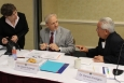 Associate Principal Deputy Assistant Secretary Alice Williams, left, and EM Senior Advisor Dave Huizenga, center, talk with Environmental Management Advisory Board Vice-Chair Dennis Ferrigno at the recent board meeting.
