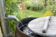 Rain barrels collect rain water and provide a free source of fresh water for your lawn. | Photo courtesy of iStockphoto/schulzie