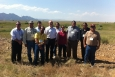 Senior Advisor for Environmental Management David Huizenga, fifth from left, and EM Office of External Affairs Director Paul Seidler, first from left, stand for a photo with leaders and staff members of the Tribal Nations while on a tour of the Rocky Flats site following the Tribal Leader Dialogue in Denver on Tuesday.