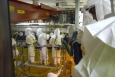 Workers wear air purifying respirators in the Plutonium Finishing Plant.