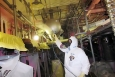 This photo is included in a report that discusses worker protective suits. The report is part of the lessons learned, best practices and other guidance now featured in the Deactivation and Decommissioning Knowledge Management Information Tool. The worker pictured, an insulator, is wearing a protective suit designed to fit better around the respirator and allow for improved breathing.