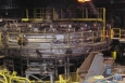 General Dynamics' Bliss Three Forge Furnace is a natural gas-fired rotary hearth furnace used to heat steel before forging. Refurbished with a new high performance refractory, high efficiency burner controls, and natural gas recuperators, the furnace improvements translated into a 25% reduction in natural gas consumption. Photo credit: General Dynamics.