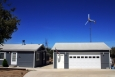 A small wind turbine can produce enough energy to cover the electricity costs of the average American home.   Photo from Bergey Windpower Co., Inc.; NREL 13830