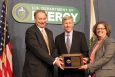 Deputy Secretary Daniel Poneman, center, presents the Secretary's Achievement Award to Oak Ridge Project Manager David Queen and Oak Ridge EM Deputy Manager Sue Cange for their work in Oak Ridge's K-33 Gaseous Diffusion Process Building Project.