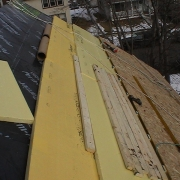 This photos shows a rigid exterior insulation installed on the roof of a house.