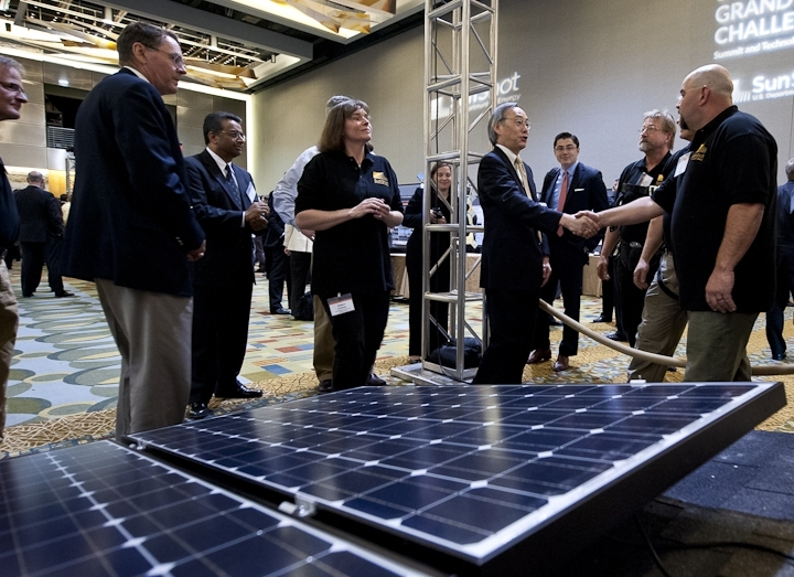 Energy Secretary Steven Chu meets with students from Front Range Community College at the Solar Instructor Training Network exhibit at the SunShot Grand Challenge Summit and Technology Forum in Colorado. | Photo by Dennis Schroeder, NREL.